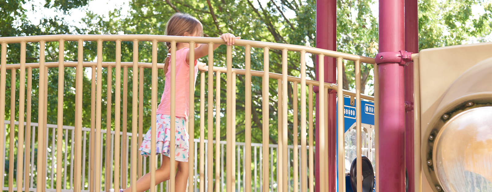 girl playing on playset at marcus autism center