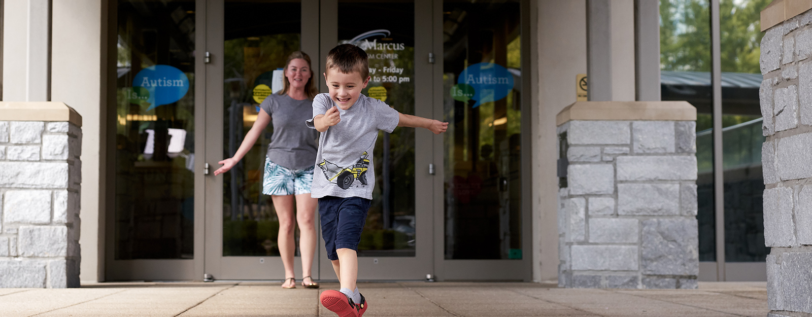 boy at marcus autism center skipping